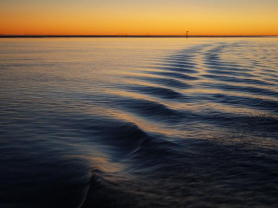 cathy-finch-ripple-lines-of-boat-in-water-in-karumba-shipping-channel-at-sunset