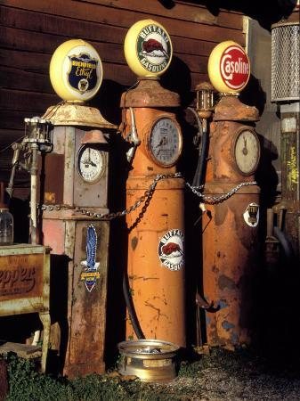 charles-benes-three-old-gas-pumps