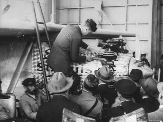 charles-lindbergh-examining-his-plane-the-spirit-of-st-louis-in-le-bourget-aerodrome