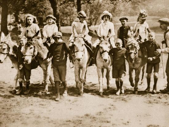 children-donkey-riding-on-hampstead-heath