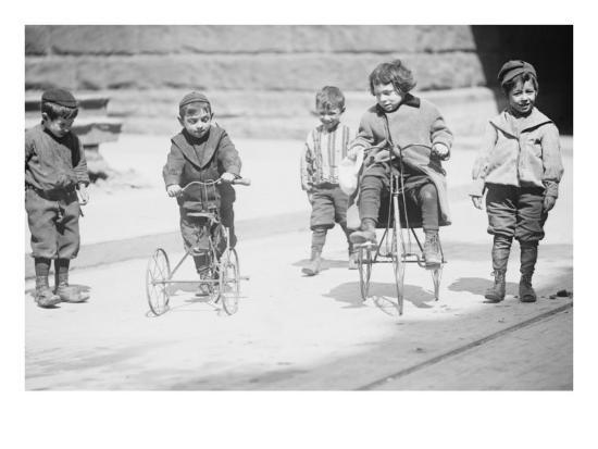 children-with-tricycles-playing-in-manhattan-street