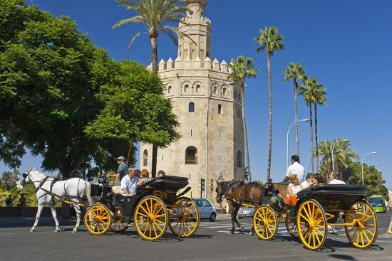 chris-seba-spain-andalusia-seville-arabian-tower-torre-del-oro-horse-drawn-carriages