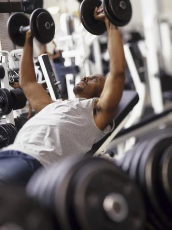 chris-trotman-male-working-out-with-weights-in-a-health-club-rutland-vermont-usa