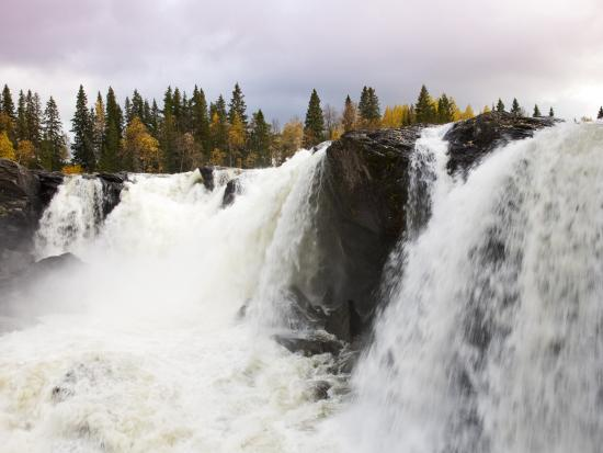 christer-fredriksson-waterfall-and-forest-in-autumn