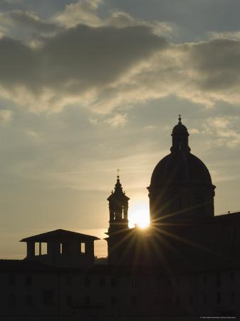 christian-kober-silhouette-at-sunset-of-church-chiesa-di-san-frediano-in-cestello-florence-tuscany-italy