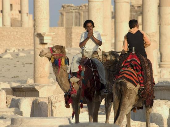 christian-kober-young-men-on-camels-archaelogical-ruins-palmyra-unesco-world-heritage-site-syria-middle-east