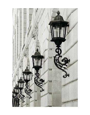 christian-peacock-lamps-on-side-of-building