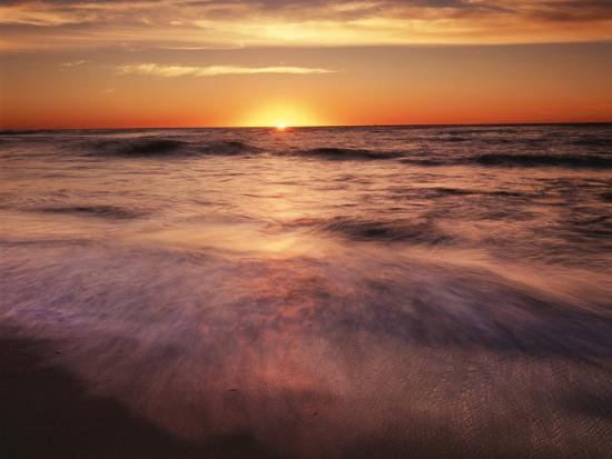 christopher-talbot-frank-california-la-jolla-sunset-over-a-beach-and-waves-on-the-ocean