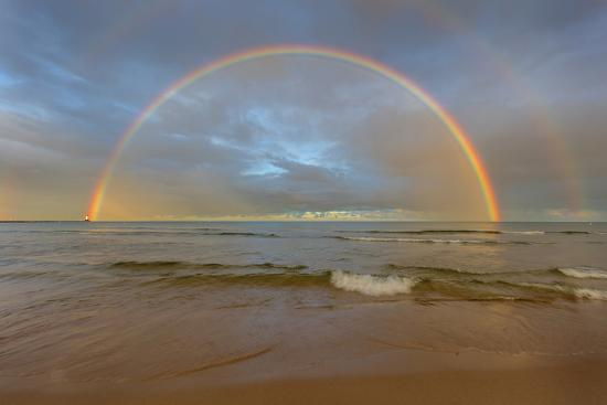 chuck-haney-full-arcing-rainbow-over-lake-michigan-and-ludington-lighthouse-in-ludington-michigan-usa