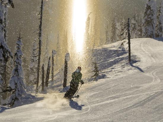 chuck-haney-skiing-through-a-sundog-on-corduroy-groomed-runs-at-whitefish-mountain-resort-montana-usa