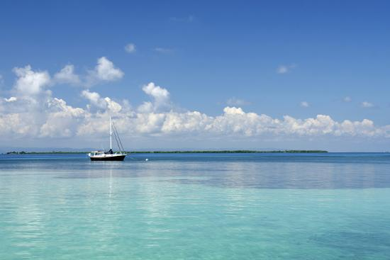 cindy-miller-hopkins-sailboat-in-clear-caribbean-sea-southwater-cay-stann-creek-belize
