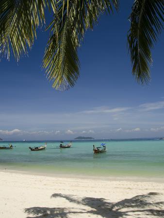 cindy-miller-hopkins-thai-longboats-along-the-coast-of-phi-phi-don-island-phuket-andaman-sea-thailand