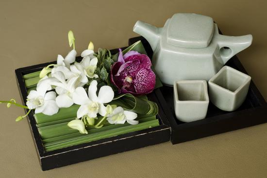 cindy-miller-hopkins-traditional-thai-tea-pot-and-cups-with-orchid-arrangement-bangkok-thailand