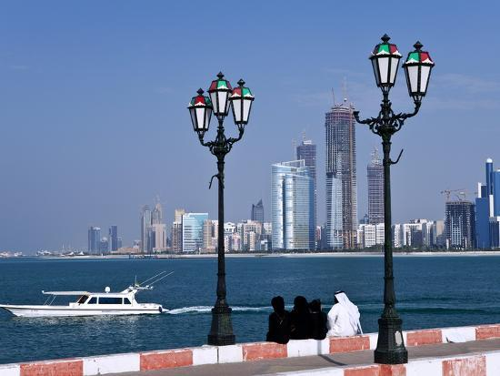 city-skyline-and-the-famous-corniche-looking-across-the-harbour-from-a-pier-abu-dhabi