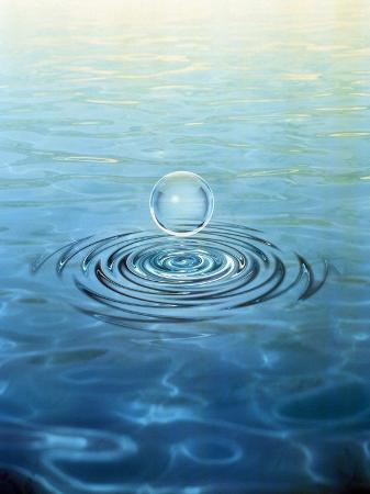 clear-bubble-floating-above-water-ripples-in-choppy-water