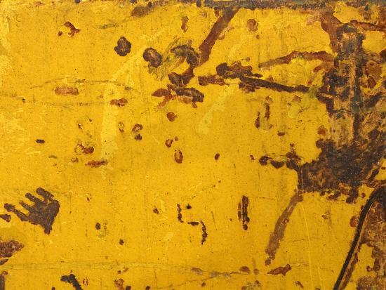 close-up-of-a-rough-yellow-wall-with-brown-scratches