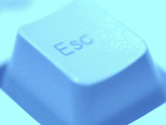 close-up-of-gray-escape-button-on-computer-keyboard