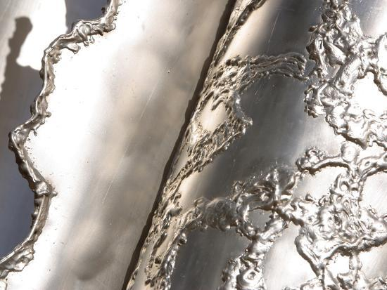close-up-of-rough-texture-engraved-on-a-shiny-metallic-surface