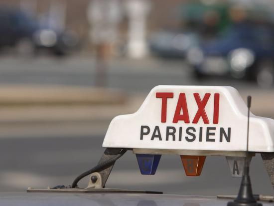 close-up-of-sign-on-roof-of-taxi-in-paris-france