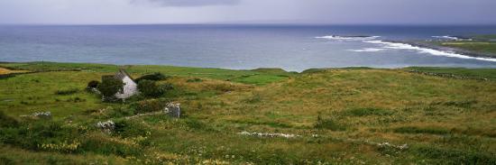coastal-landscape-with-white-stone-house-galway-bay-the-burren-region-ireland