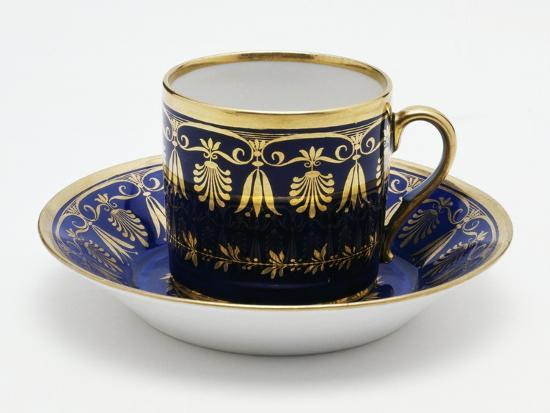 cup-and-saucer-decorated-with-palmettes-and-tendrils-on-blue-background