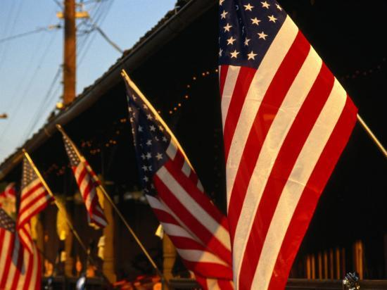 dallas-stribley-flags-hanging-outside-diner-texas-usa