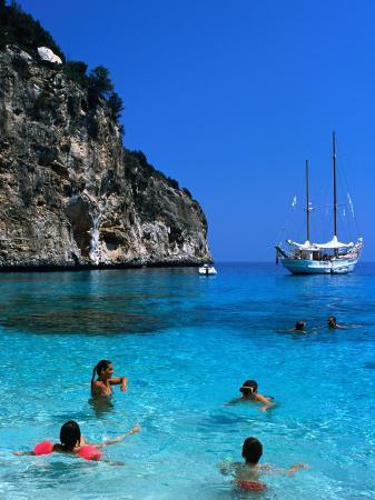 dallas-stribley-tourists-swimming-in-waters-of-cala-mariolu-in-gulf-of-orosei-sardinia-italy