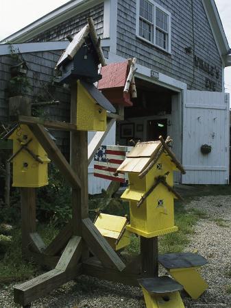 darlyne-a-murawski-bird-houses-for-sale-outside-a-barn