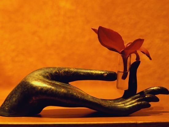 dave-bartruff-sculpted-hand-holding-massage-oil-vial