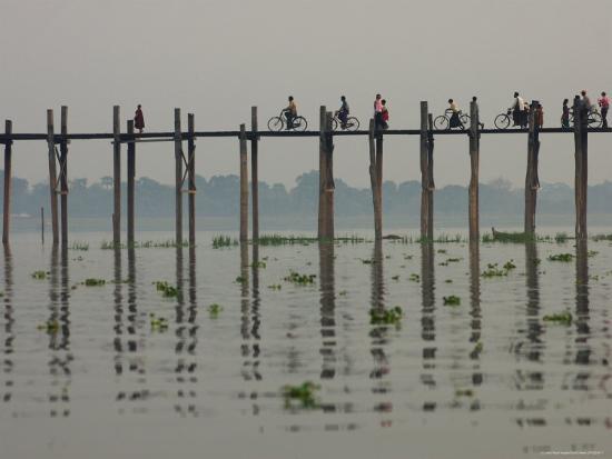 david-greedy-people-ride-their-bicycles-along-u-bein-s-bridge-that-runs-down-the-taungthaman-lake