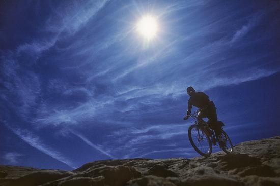 david-hiser-a-mountain-biker-on-slickrock-trail-near-moab-utah