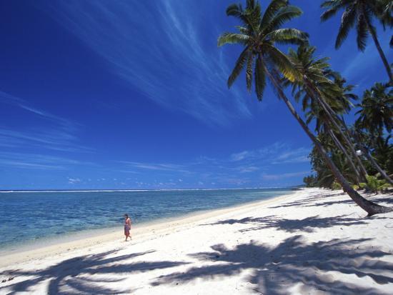david-wall-tambua-sands-resort-girl-on-beach-and-coconut-palm-trees-coral-coast-melanesia