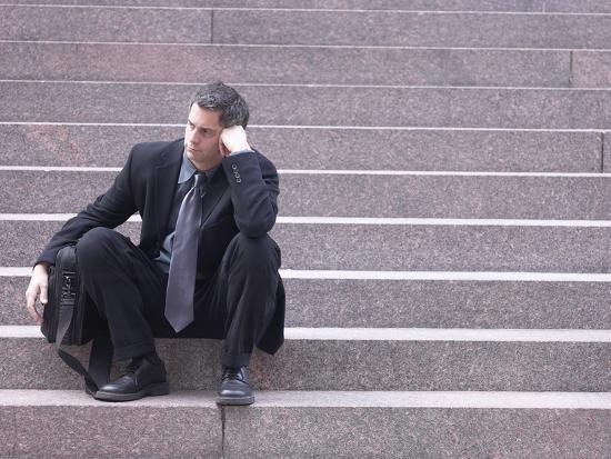 dejected-business-sitting-on-steps