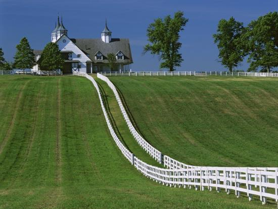 dennis-flaherty-double-white-fence-flows-from-an-elegant-horse-barn-woodford-county-kentucky-usa