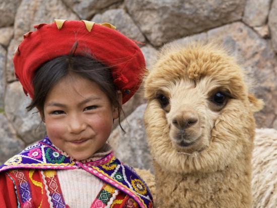 dennis-kirkland-girl-in-native-dress-with-baby-alpaca-sacsayhuaman-inca-ruins-cusco-peru