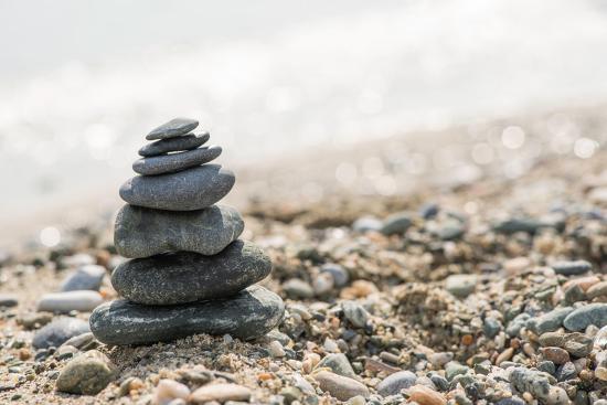 deyan-georgiev-stacked-sea-stones-sea-on-the-contra-light