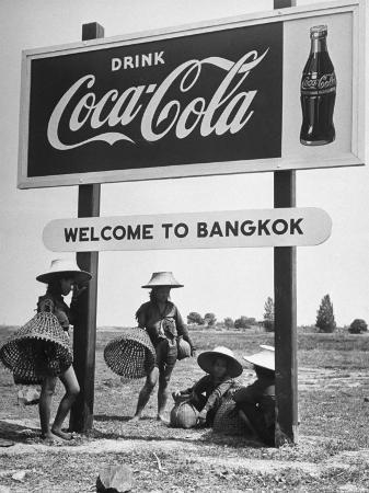 dmitri-kessel-billboard-advertising-coca-cola-at-outskirts-of-bangkok-with-welcoming-sign-welcome-to-bangkok