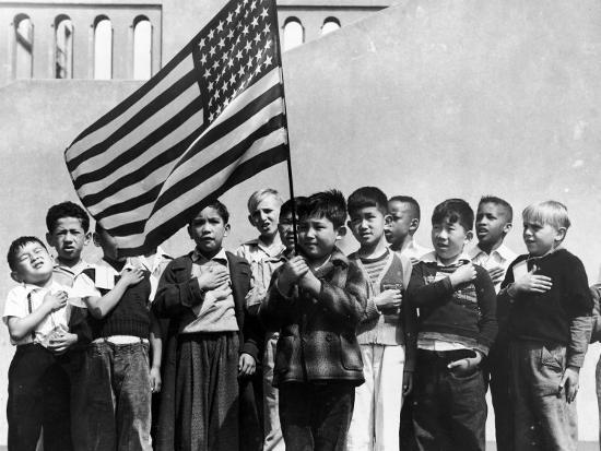 dorothea-lange-american-children-of-japanese-german-and-italian-heritage-pledging-allegiance-to-the-flag