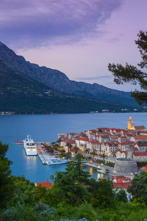 doug-pearson-elevated-view-over-korcula-s-picturesque-stari-grad-old-town-illuminated-at-dusk