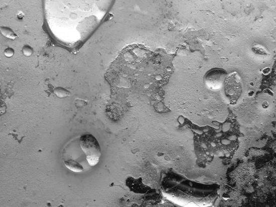 droplets-of-water-on-gray-mottled-steel-surface