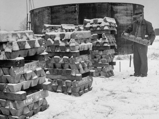 ed-clark-ingot-of-magnesium-part-of-the-u-s-strategic-materials-stockpile-stacked-and-covered-with-snow