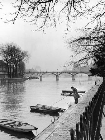 ed-clark-rowboats-tied-up-along-the-seine-river