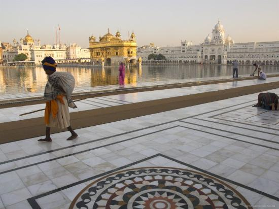 eitan-simanor-elderly-sikh-pilgrim-with-bundle-and-stick-walking-around-holy-pool-amritsar-india