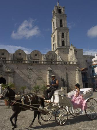 eitan-simanor-elegant-woman-riding-in-horse-and-carriage-plaza-san-francisco-de-asis-havana-cuba