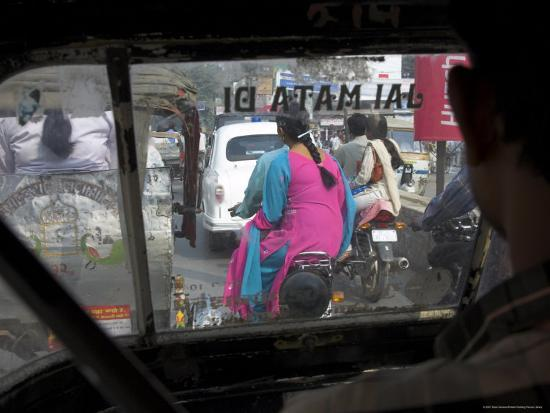 eitan-simanor-women-riding-on-back-of-motorcycles-in-heavy-traffic-viewed-from-inside-a-motor-rickshaw