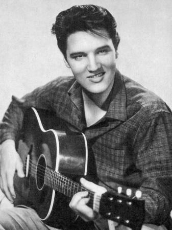 elvis-presley-american-pop-singer-guitarist-and-actor-in-musical-films-seen-here-with-his-guitar