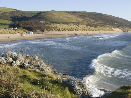 ethel-davies-the-beach-with-surfers-at-woolacombe-devon-england-united-kingdom-europe