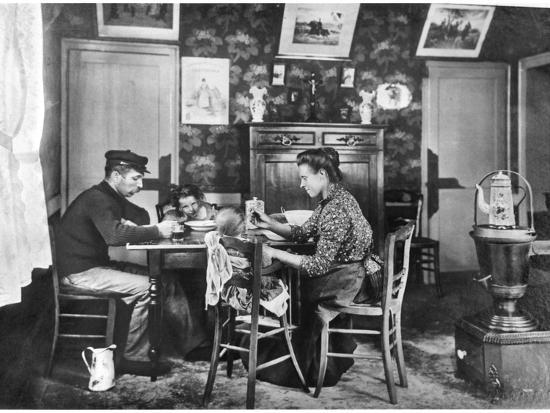 family-around-a-table-from-a-photo-album-on-housing-development-in-lens-1906