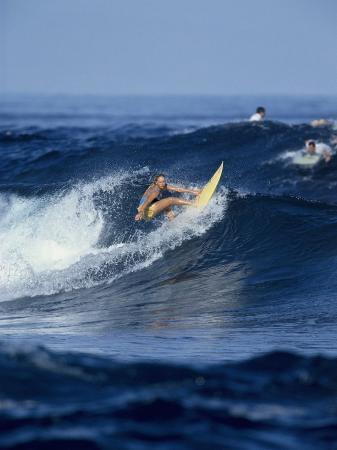 female-surfer-riding-a-wave