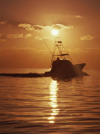 fishing-boat-with-sunset-sky